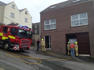 Fire fighters investigate the cause of a blaze in Milford Haven