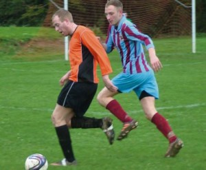 Johnston's Adam Hawkins shields the ball from an Evans & Williams defender.