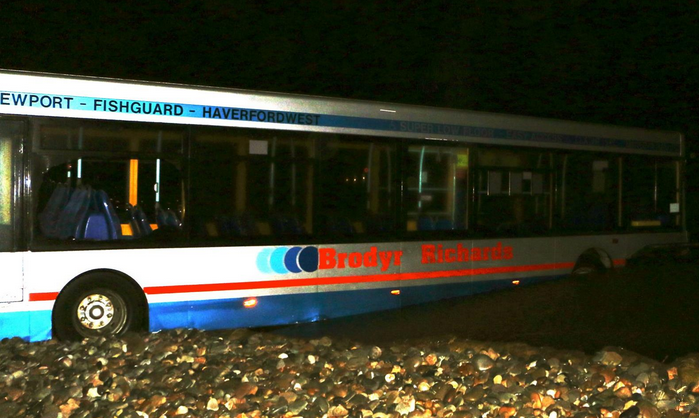 Bus stranded in Newgale. Pic: Y Tanaka