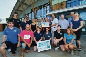 High standards: Pictured are members of staff from Haverfordwest Leisure Centre, who all contributed towards the success of achieving the award, with Manager Sian Fair, Deputy Manager Darryl Sable, Cllr Elwyn Morse and Director of Adult Care and Leisure Pam Marsden, plus Chris Payne, Gary Nicholas, and Julie Townsend from Pembrokeshire Leisure.