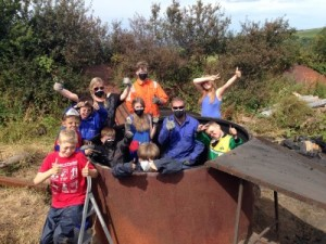 Charcoal making: Point Youth Club Fishguard members with Ranger Richard Vaughan.