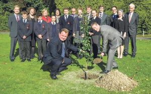 Tree planting: National Director plants tree as part of the 'Boarding Orchard'.