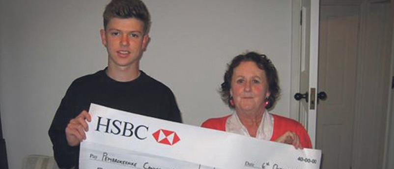 Presenting the cheque: Funds raised for Pembrokeshire Cancer Support.