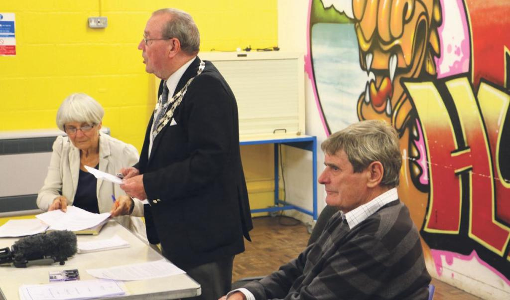 Milford Haven Mayor: Cllr Eric Harries addresses the community, Cllrs Viv and Mike Stoddart sit either side.