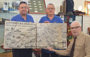 Panels presented to Heritage Centre: Owen Vaughan with volunteers Malcolm Miles and Steve Fletcher (Pic. Martin Cavaney).