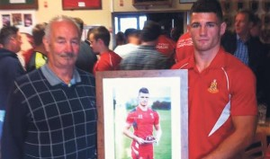Photograph presentation: Jordan Roberts presents Gwyn French with a photograph of himself.