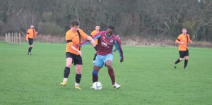 Saints scorer Dan Ramsey: Challenged for the ball by a Johnston player.