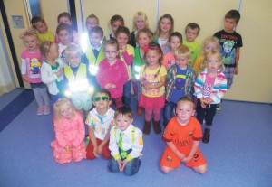In Neon: Pupils celebrate 'Let's Glow Day'.