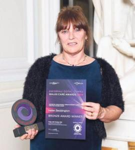 Inspirational carer: Helen was awarded for her work.