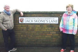 Mr Jonnie Skone (son of John Skone): Pictured by the new sign with Councillor Melanie Phillips