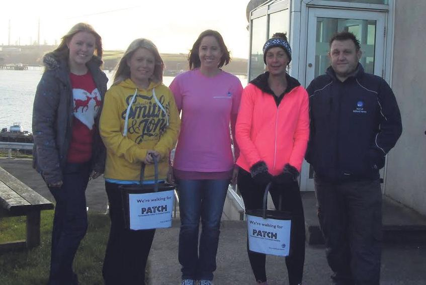 (Left to right) Sara Andrew, Anna Malloy, Vidette Swales, Clare Stowell and Kris John from the Port of Milford Haven take part in a sponsored walk for PATCH