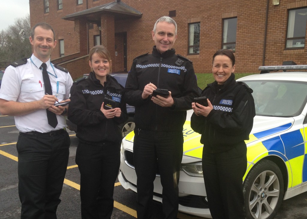 New phones: PC 385 Ben Ashton, PC 76 Leah Evans, PC 376 Phil Westbury and PC 905 Eleri Edwards with their mobile digital policing devices.