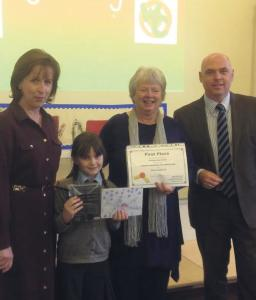 Mrs Roberts: Headteacher of St Francis Catholic Primary School, pictures with competition winner, Phoebe Whitwham, Pembrokeshire artist and judge, Cynth Weyman and Paul Davies AM.