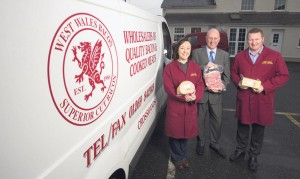 Bringing home the bacon: Kim and Chris Isaac with Finance Wales executive Tony Dowrick
