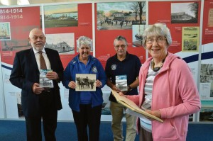 Mrs Pat Singleton pictured at the Pembroke Dock Heritage Centre with, left to right: David Pring of Sinewave and Sunderland Trust Volunteers Margaret Black and Rik Saldanha. Pat is holding her husband's logbook which, along with other items, are now part of the Sunderland Trust Archive. (Martin Cavaney Photography.)