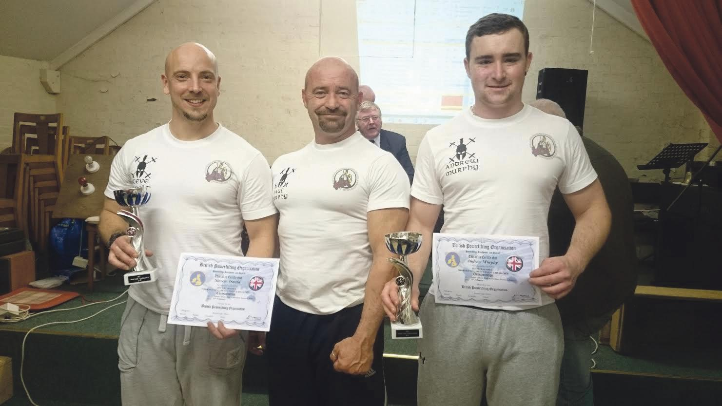 Powerlifters: Steve Arnold (left), coach and multiple world champion Paul Murphy (middle) and Andrew Murphy (right) with trophies.
