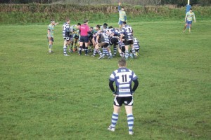 Scrum time: Winger Sam Kurtz looks on as Fishguard and Laugharne prepare to scrummage.