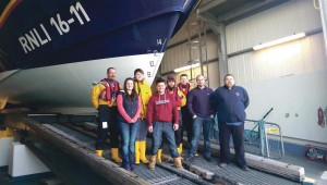 Fundraiser: Alex with Coxswain Lewis Creese and members of the Angle lifeboat crew.