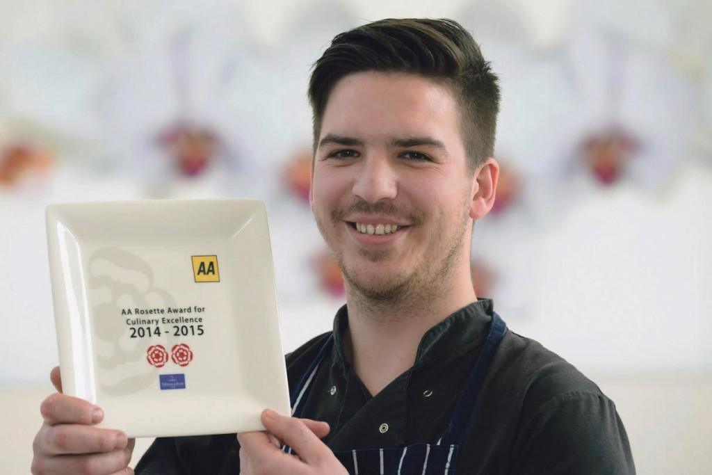 Success on a plate: Tom Simmons, head chef at the Wolfscastle Country Hotel,with the establishment's AA two rosette award. (Pic. Gareth Davies).