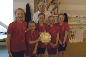 Lamphey Primary School's winning girls relay team: With Mr Bob Adams who has recently been awarded the Life Time Achievement Award from Swim Wales.