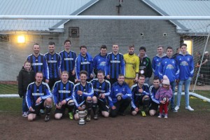 Champions: Hakin United celebrate their third title in a row