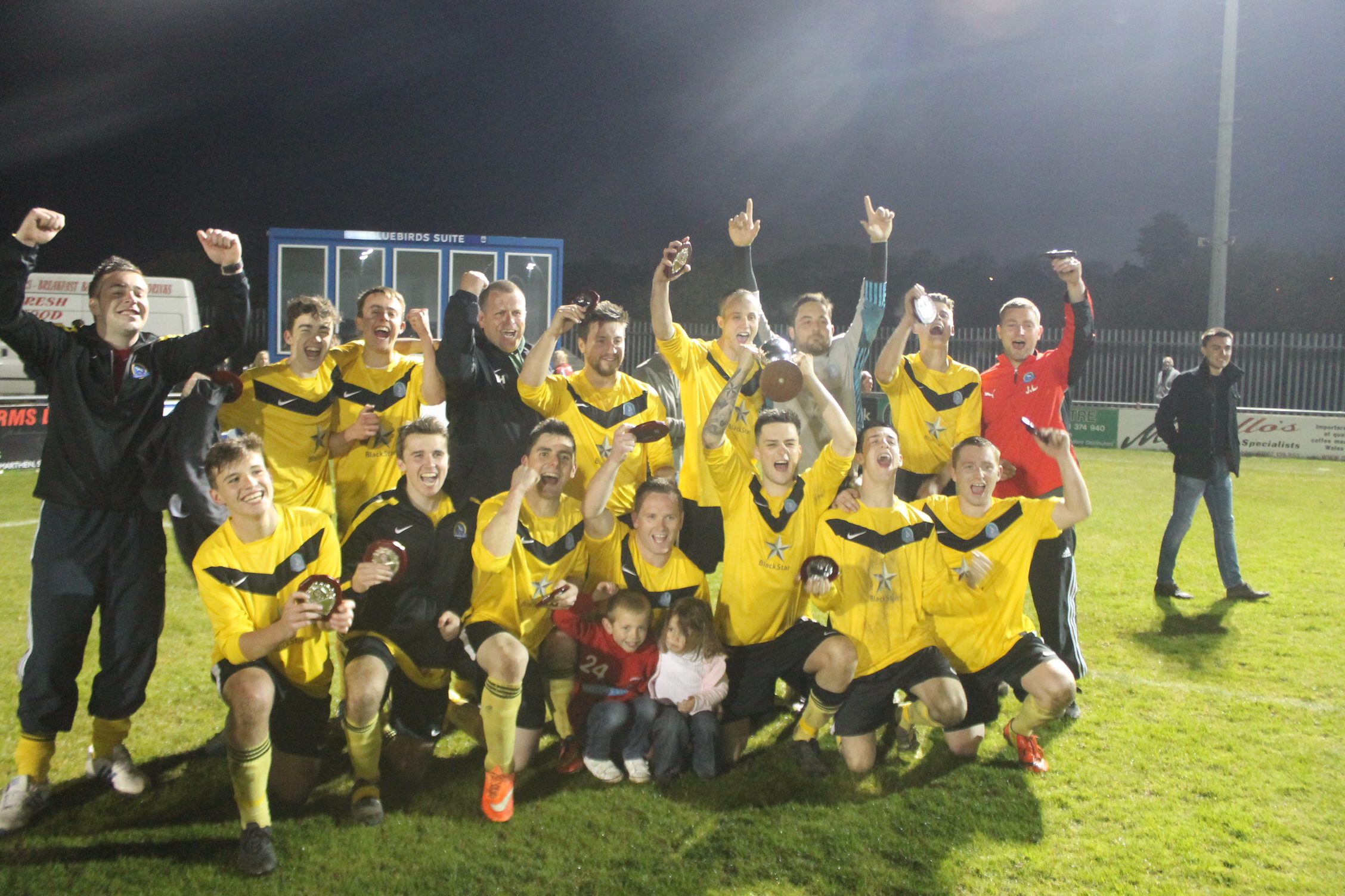 Winners: Hundleton's players celebrate winning the Second Division Cup