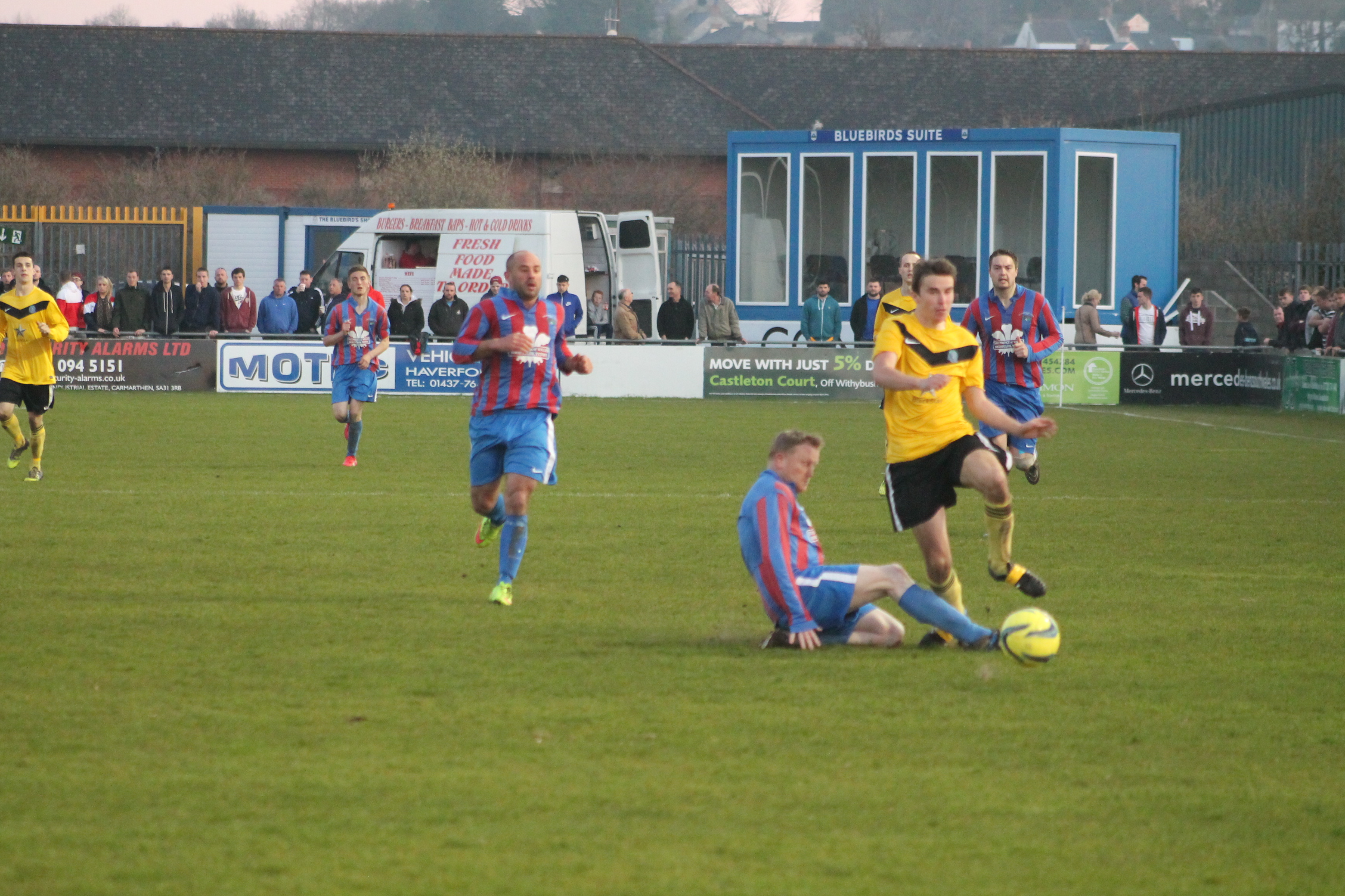 Challenge: Hundleton's Jason Donohoe is brought down by Steff Atyeo