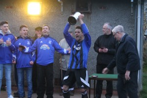 Delighted: Captain Jonathan Bennett lifts the trophy