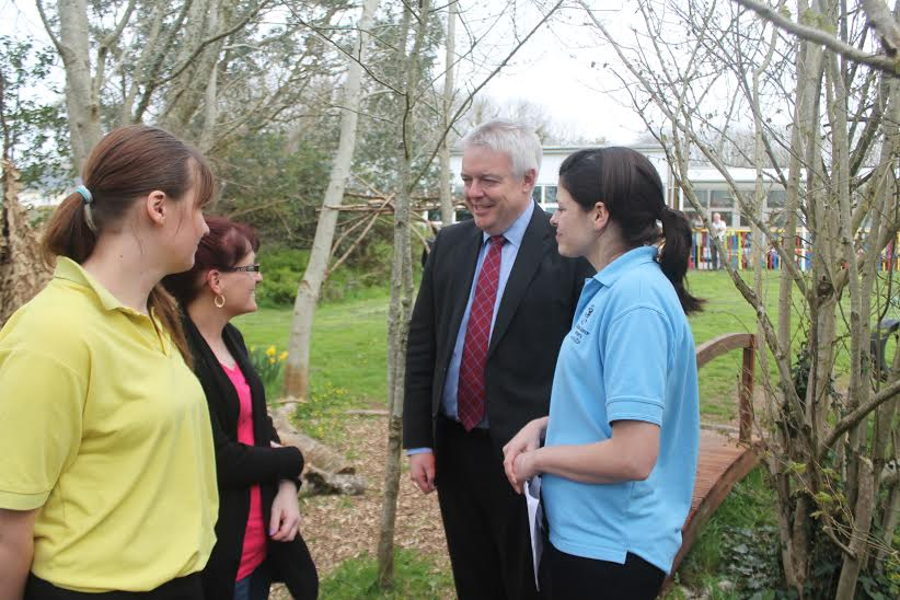 Flying visit: The First Minister chats with a parent and two members of staff at the Flying Start Centre