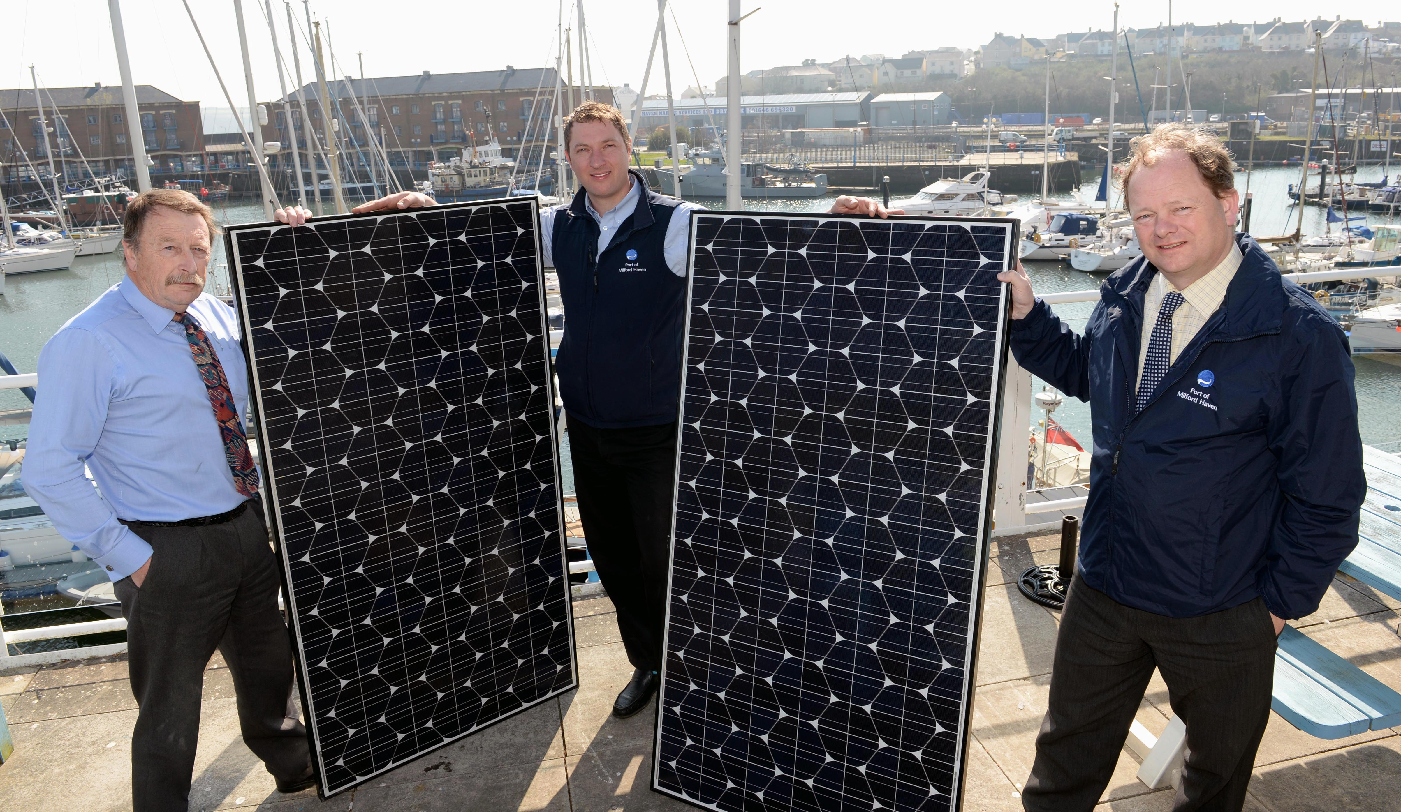 Dave Levell, Environmental Manager; Tim James, Energy Manager and Alec Don, Chief Executive of the Port of Milford Haven celebrate becoming carbon neutral