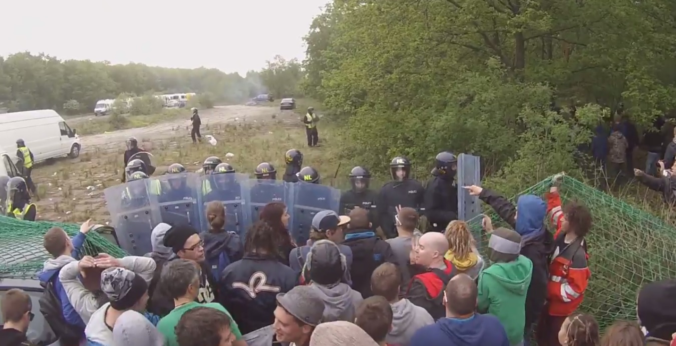 Police in riot gear trying to shut the illegal rave
