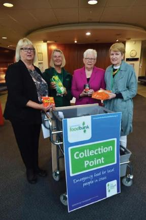 Pictured at the County Hall foyer drop-off point are: Councillor Sue Perkins; Tirzah Redman; Councillor Pat Davies, Chairman of Children