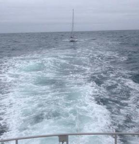 The 9m yacht under tow to Milford Haven by RNLI Angle's all weather lifeboat on Sunday (31 May) • Photo: RNLI Angle
