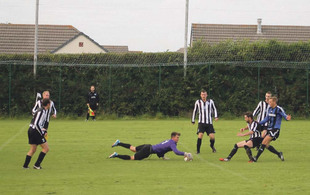 Save: Mike Chandler reaches for the ball as Hakin put pressure on the Neyland goal