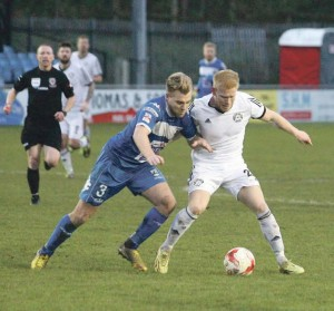 Challenge: Ryan Batley tackles Rhyl scorer Connor Bell Pic: Gareth Hughes/sportspix.wales