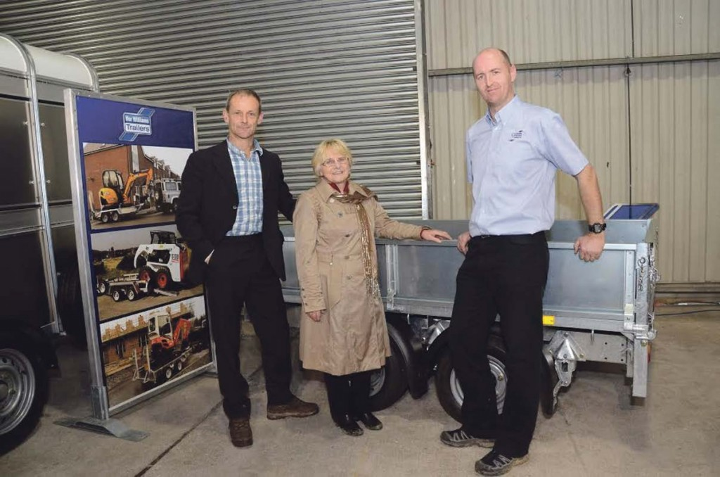 Winners: Ffermio presenter Alun Elidyr (left) with Mrs Thomas and Llion Roberts from Ifor Williams Trailers