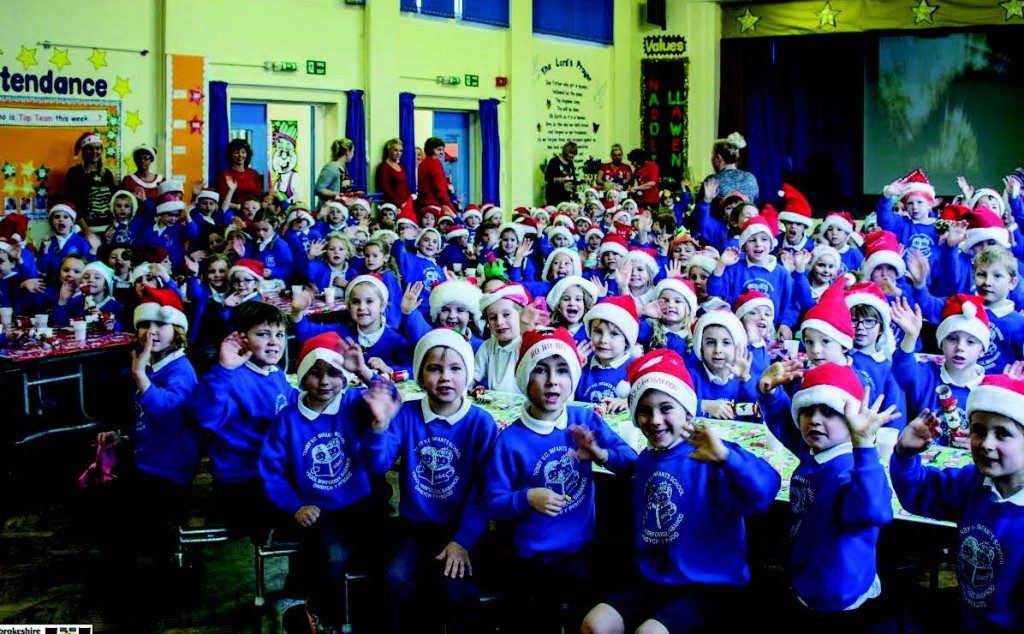 All the trimmings: Tenby Infants having a Christmas dinner on Wednesday, the last before the new school opens in September