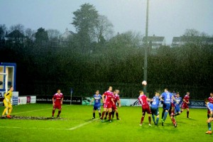 Chance: Sam Rodon's header goes narrowly over as the rain comes down