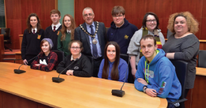Cllr Wynne Evans (centre) and Nadine Farmer (far right) from the Children and Young People's Rights Office: With members of the Youth Assembly (L-R) Elin Rees, Talia Jones, Daniel Bowen, Amy Lewis, Caitlyn Nutting, Hayden Gove, Bethany Roberts, Bryani Kelly, and Jamie Bevan