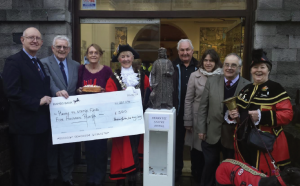From left to right: Councillor Aden Brinn, Mr George Lewis, Councillor Linda Asman, Mayo of Pembroke Councillor Pauline Waters, Councillor Wyn Jenkins, Rachel Norman, Councillor Clive Collins and Town Crier Councillor Rose Blackburn, with Gracie the town dog