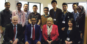 Pictured (back row): Some of the international junior doctors with (front row, left to right) Dr. Chris James, Consultant Physician, Vaughan Gething, Deputy Health Minister, Bernardine Rees, Chair of Hywel Dda UHB and Erika Cowie, Deputy Medical Education Manager for Withybush