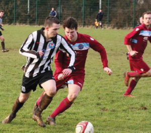 On the run: Justin Harding goes past a St Clears player