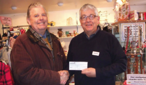 L-R: Ashley Warlow presenting a cheque to Bernie George, charity Trustee