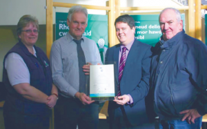 Award: Dog warden Sally Bland and chairman of the Environment, Overview and Scrutiny Committee Councillor Brian Hall are pictured alongside RSPCA Cymru public affairs manager Paul Smith who is presenting the award to principal environmental health officer Tom Hayes