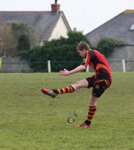 Winning kick: Llyr Tobias kicks the winning points for Cardigan against Neyland
