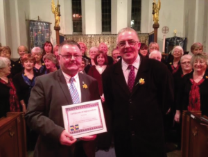 Award: Peter Griffiths with Council Chairman Wynne Evans
