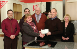 Peter Williams, Manager of Howdens Neyland Depot: with staff members Carl Asparassa, Andrew Dawes, Richard Stocker, Kelly Fretwell and Jayne Axford, present a cheque to Elizabeth Sleight of the Harriet Davis Trust