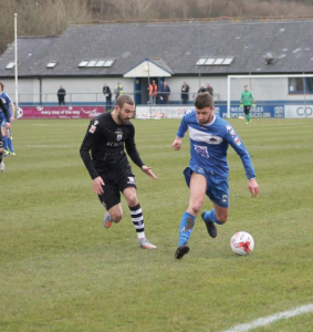 Late goal: Luke Borelli halts his run being chased by a Port Talbot player