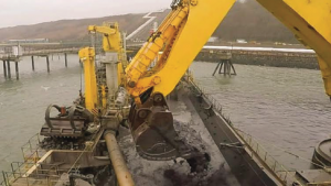 Giant bucket: The dredging vessel Mimar Sinan clears sediment from around a jetty in the Port of Milford Haven