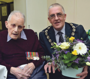 Displaying his war medals: Including The Burma Star - Mr Rees is pictured with Councillor Wynne Evans